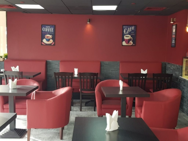 Coffee shop furniture supplied in UAE - comfortable single seater custom made sofas and durable scratch resistant tables