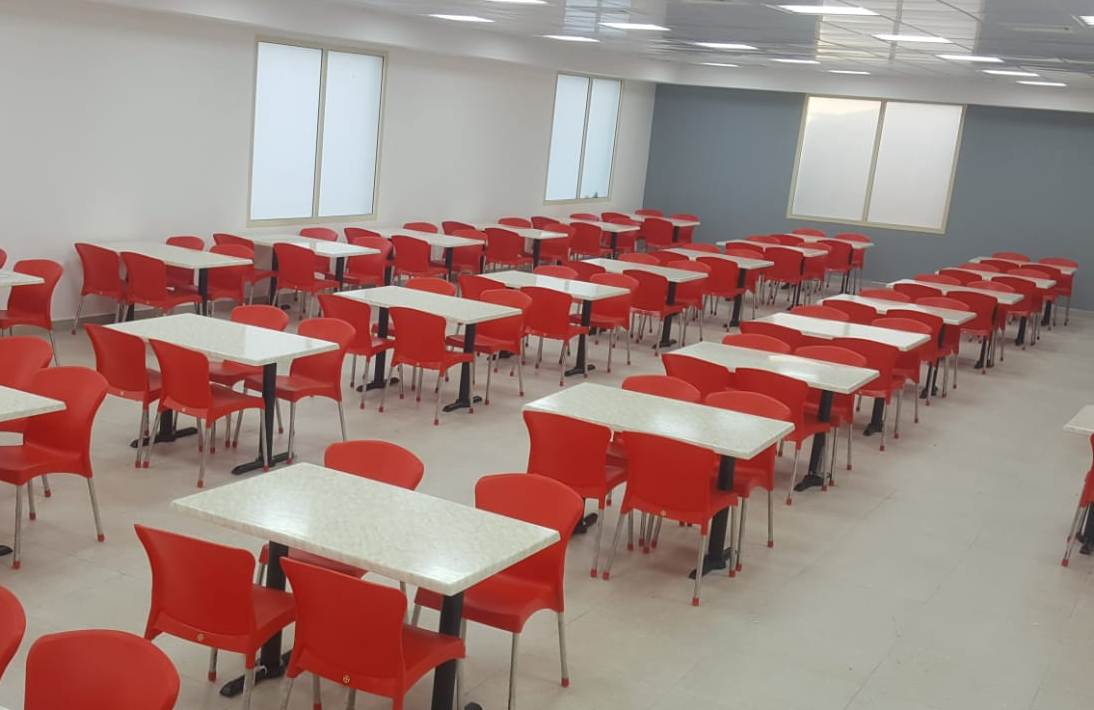 Staff canteen furniture -  red polypropylene chairs and Durable tables