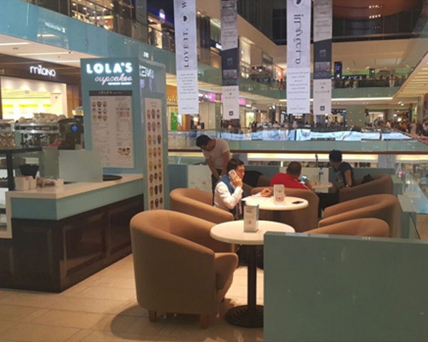 Coffee shop sofas and marble light tables in Dubai Mall