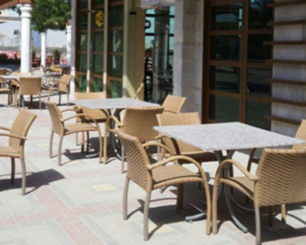 rattan chairs with outdoor tables in Ras Al Khaimah